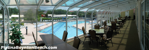 For those days when you want to be at the pool but you don't want the heat and humidity, there is this upstairs glassed-in patio. Relax in air conditioned comfort while taking in this fantastic view of the pool area on a sunny day.